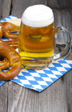 Glass of cold beer and pretzels Stock Image