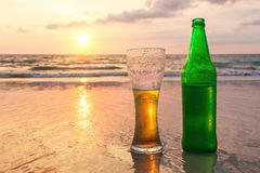 Glass of cold beer on the sea shore at the sunset. Relax on the beach. Vacation. Resort holiday Stock Images