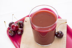 Glass of Cold cherry juice Royalty Free Stock Images