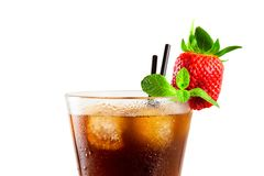 Glass of cold coffee or tea with ice cubes, strawberry and mint Stock Photo