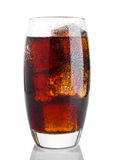 Glass of cold cola soda drink with ice cubes Royalty Free Stock Photos