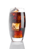 Glass of cold cola soda drink with snow and ice Stock Image
