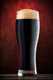 Glass of cold dark beer Stock Photography