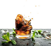 Glass of cold drink with ice and mint leaves Stock Images