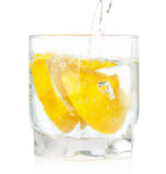 A glass of cold drink with a lemon from the fridge. Stock Photos