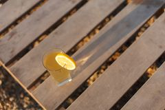 Glass of cold drink on old wooden background top view, selective focus. Glass of cold drink on old wooden background, top view, selective focus Royalty Free Stock Photos