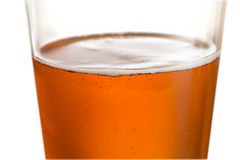 Glass of cold golden beer with focus on edge Stock Photo