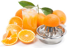 Glass of cold juice and fresh piece of orange Stock Photo