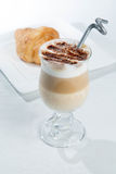 Glass of cold latte coffee topic cocolate cream on white background with desserts Stock Photo