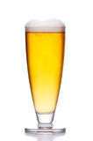 Glass of cold light beer with foam on white Stock Photography