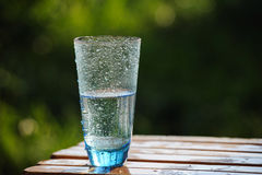 Glass of cold mineral water on the table outdoor Stock Photo