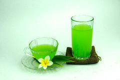 Glass of cold Pandan juice - healthy food against wood,With pan Stock Photography