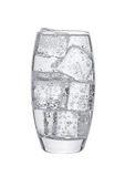 Glass of cold sparkling water with ice cubes. On white background Royalty Free Stock Image