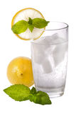 Glass of cold sparkling water with lemon and mint Royalty Free Stock Photos