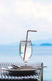 Glass of cold water on dining table on the island Royalty Free Stock Photography