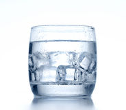 Glass of cold water and ice on background Stock Photo