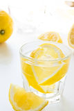 Glass of cold water with lemon Stock Images