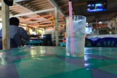 Glass of cold water on table royalty free stock images