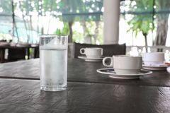 Glass of cold water on table royalty free stock photo