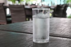 Glass of cold water on table stock photos