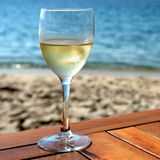 Glass cold white wine mediterranean beach table square. Glass cold white wine mediterranean beach table stock photography