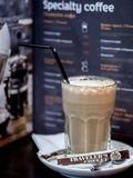 Glass of collee latte in `Travellers Coffee` Stock Photos