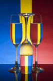 Glass on a colors background (Red ,Blue ,Yellow) stock image