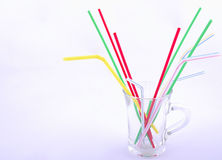 Glass and colour straw Royalty Free Stock Image