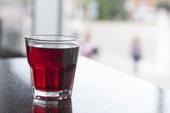 Glass of compote on table Royalty Free Stock Photos