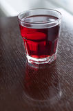 Glass of compote on table Stock Images