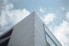Glass and concrete gray building of modern city Stock Photography