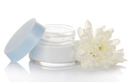 Glass container of cream and fresh flower Stock Image