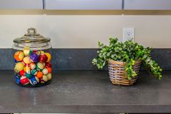 Glass Container Of Pool Balls. & Small Plant On Display Royalty Free Stock Images
