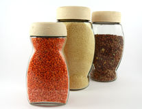Glass containers with lentils and breadcrumb. Three jars with lentils and breadcrumb on white background Stock Images