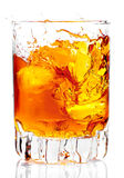 Glass containing rum, whisky or any  golden liquor. Glass containing rum, whisky or any other golden liquor with ice on a white background Stock Image