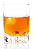 Glass containing rum, whisky or any other golden l Royalty Free Stock Photos