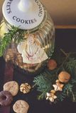 Cookie jar and angel ornament. Glass cookie jar with cookies, green twigs and angel ornamnet Stock Image