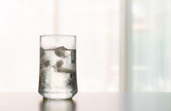 Glass of Cool fresh drink with ice cube on the  table Royalty Free Stock Image