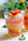 A glass of cooling citrus drink with strawberry Stock Photo