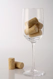 Glass with corks. A glass with corks inside on a neutral background Royalty Free Stock Image