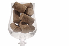 Glass and corks close Royalty Free Stock Photos