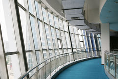 Glass corridor in office centre Stock Image
