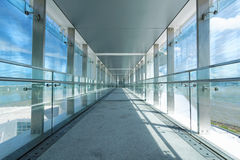 Glass corridor in office centre Stock Images