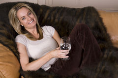 Glass couch happy Stock Photography