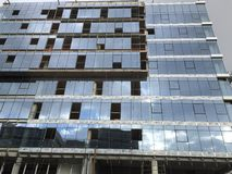 Glass covered building on construction Stock Photography