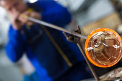 Glass crafting worker make glass souvenir Royalty Free Stock Photography
