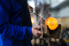 Glass crafting worker make glass souvenir Stock Photography