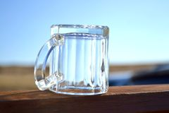 Glass creamer pitcher upside down Royalty Free Stock Image