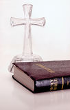 Glass cross and bible Royalty Free Stock Photography