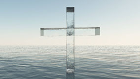 Glass cross in the sea Stock Images
